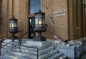 Power returns to the iconic light fixtures outside the U.S. Post Office on Second St. in Napa, Calif., five hours after the South Napa earthquake Sunday morning, Aug. 24, 2014. (Karl Mondon/Bay Area News Group)